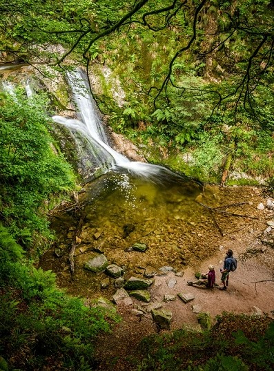 Black Forest: couple is hiking, waterfall, lake, feet