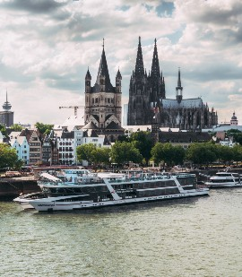 KD ship with Cologne cathedral in background